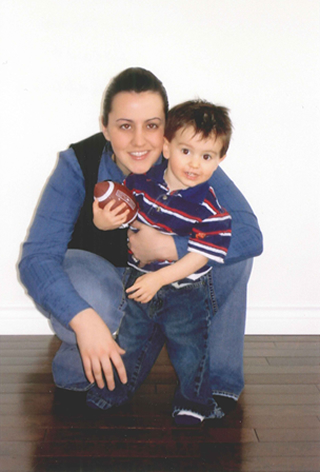 Student Lise Thiessen with her son